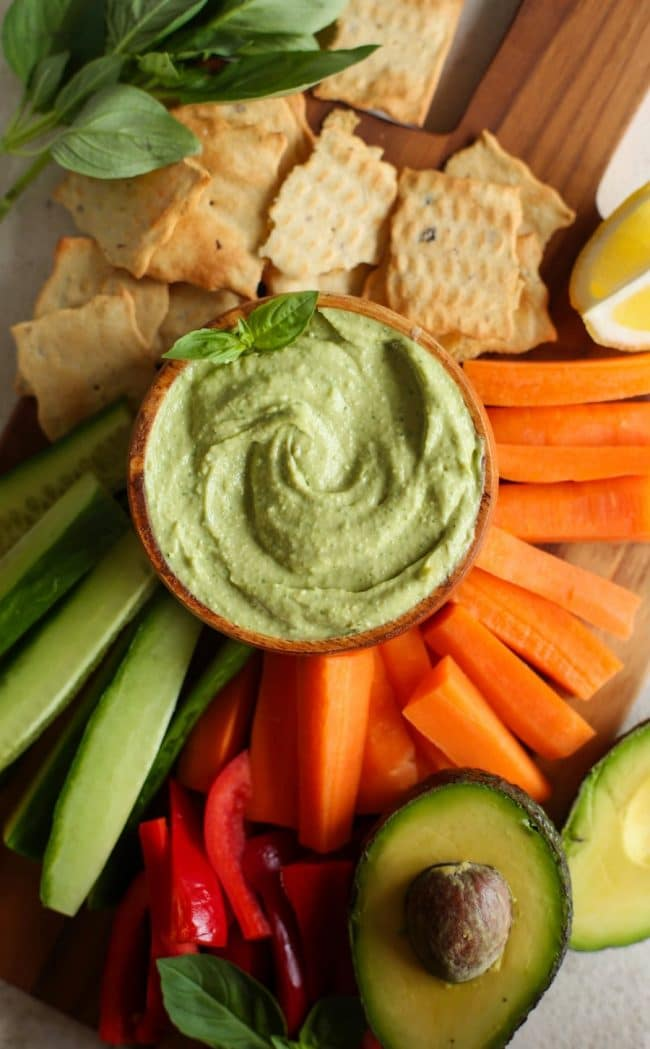 Creamy Basil Avocado Dip on a veggie platter