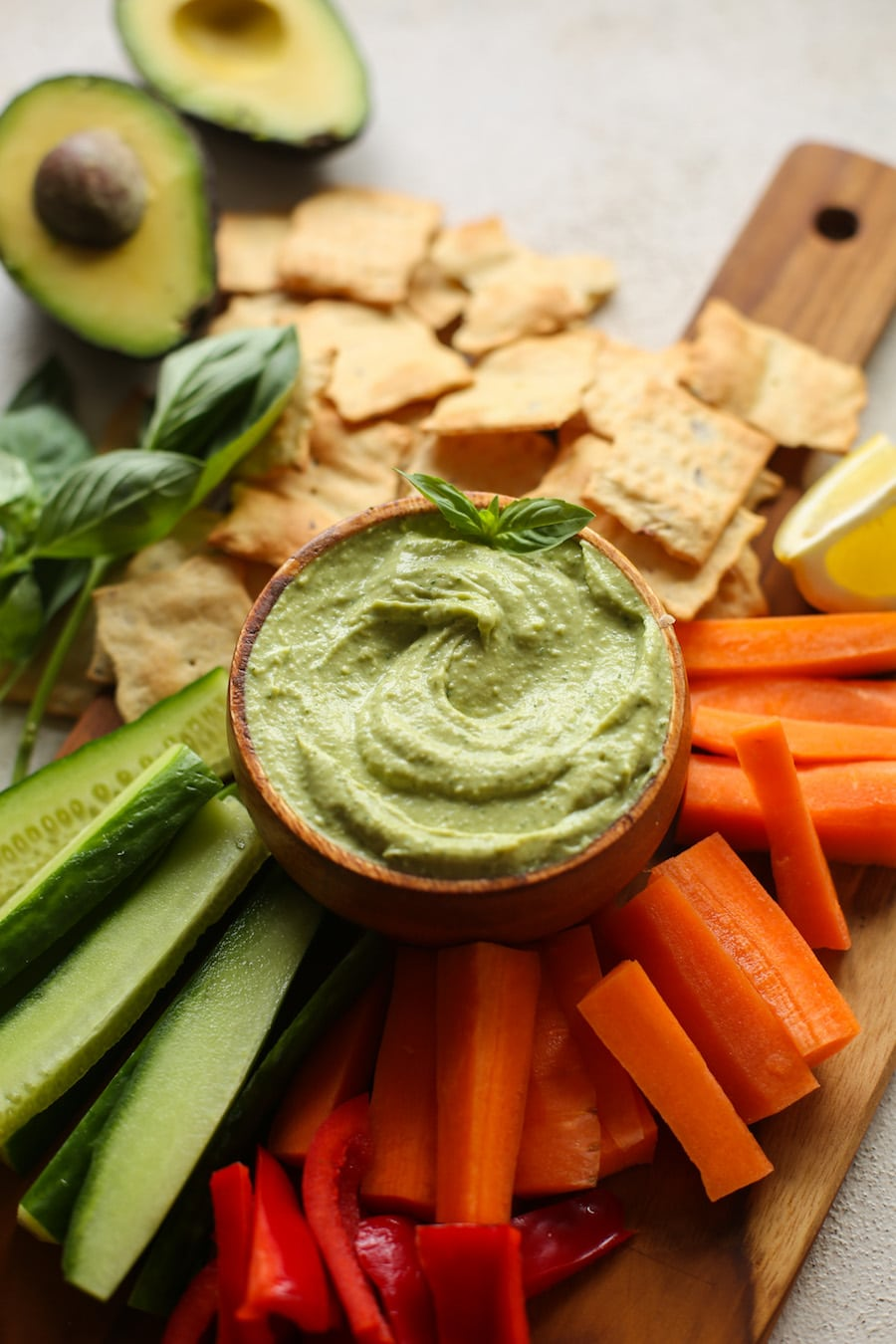 Creamy Basil Avocado Dip made with avocado, lemon juice, garlic, tahini, sea salt & fresh basil.   Gluten Free + Vegan + Paleo