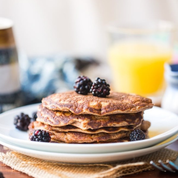 Coconut Flour Pancakes in a plate topped with blackberries