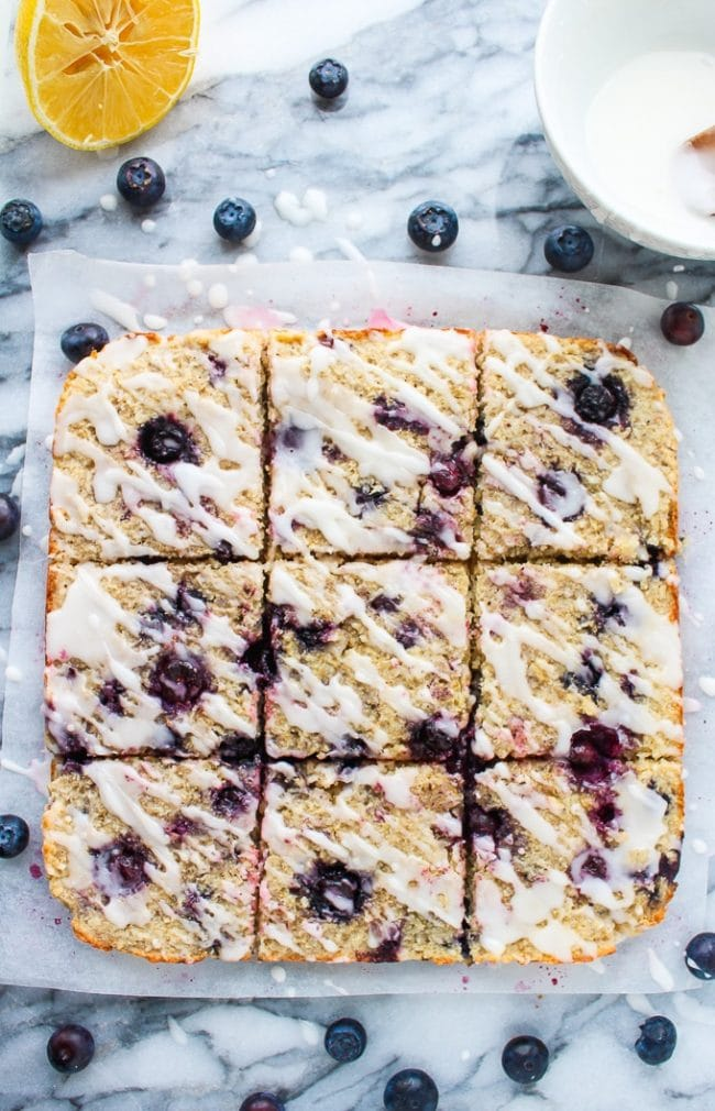 Sweet and chewy Blueberry Coconut Oat Square topped with a lemon glaze