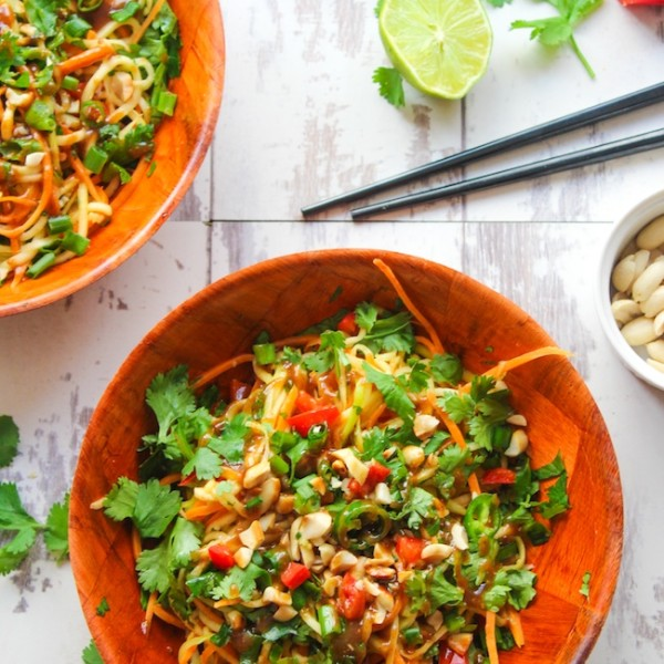 Veggie Pad Thai Salad with a sweet and savory peanut dressing - ready in 15 minutes or less. This spicy noodle bowl uses julienned zucchini in place of noodles making it perfect as light lunch or dinner side.