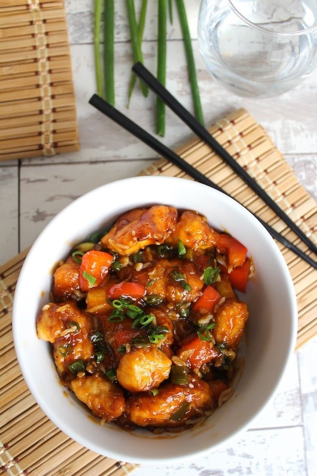 Paleo & Low FODMAP Sweet and Sour Chicken in a bowl with chop sticks