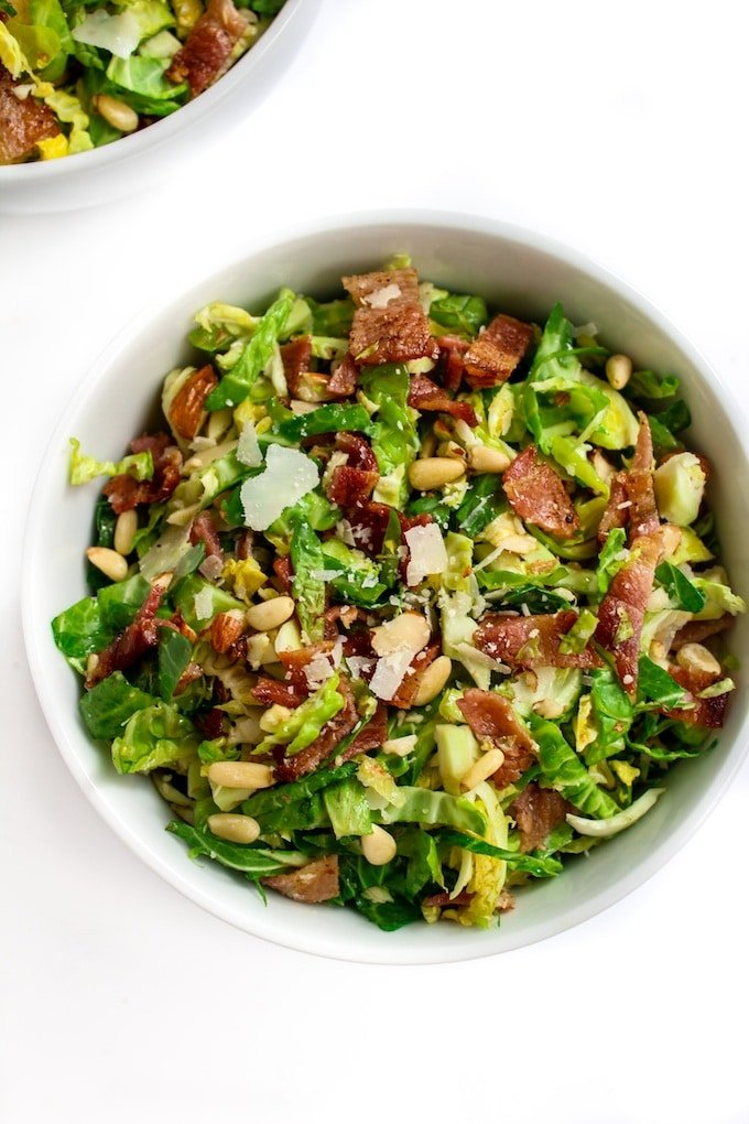 Bacon & Brussels Sprout Salad with crushed almonds, pine nuts, parmesan, and lemony garlic dressing