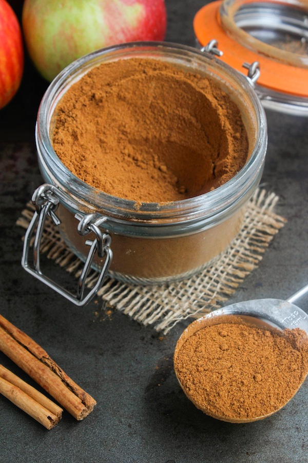 DIY Apple Pie Spice in a jar with a tablespoon