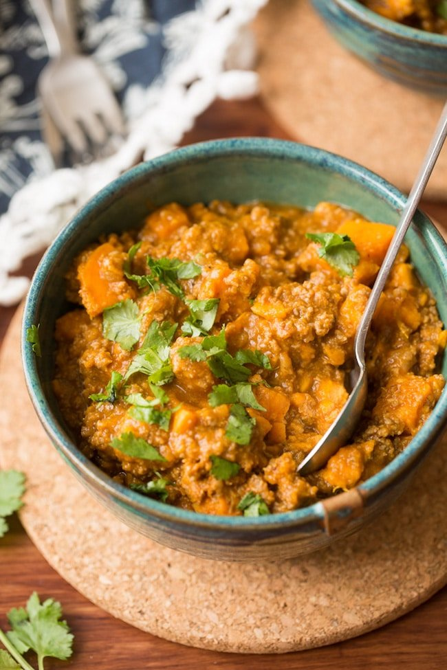 Paleo Chili Sweet Potato in a bowl with a spoon stick out