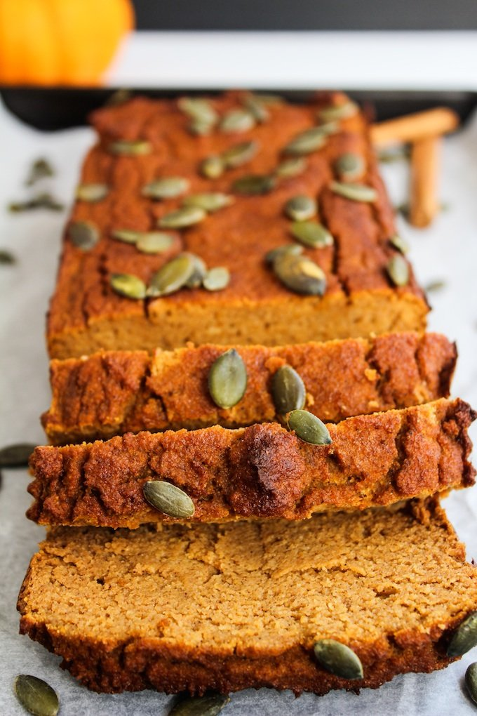Paleo Pumpkin Bread sliced and topped with pepitas