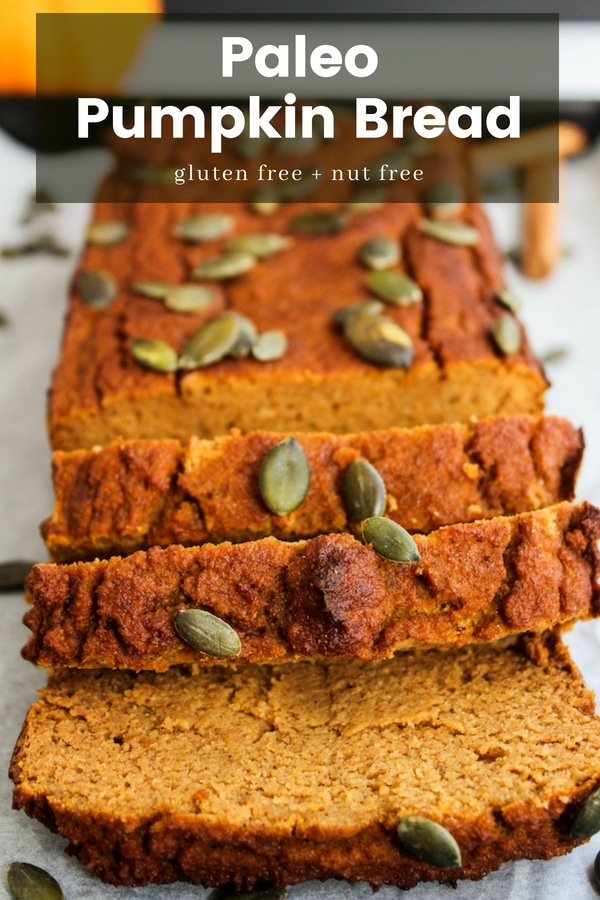 paleo pumpkin bread sliced and topped with pepitas with recipe name