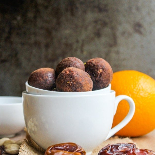 Homemade chocolate orange nakd bites made with just five ingredients – dates, raisins, cashews, cocoa, and a touch of orange zest.