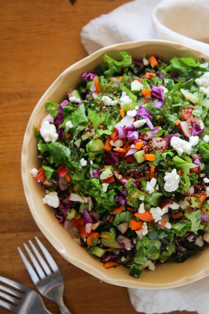 Chopped farm salad with quinoa and loaded garden greens, radish, cucumber, cabbage, carrot avocado, feta and topped with an easy orange vinaigrette.