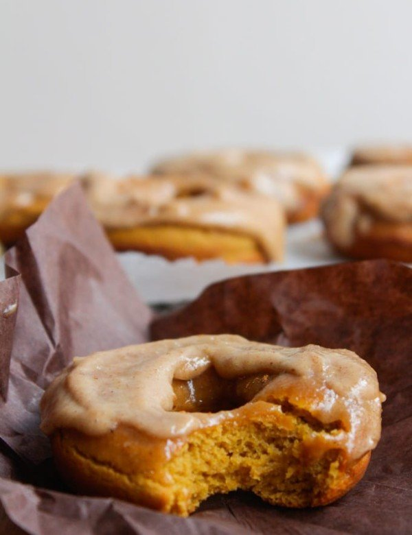 Baked paleo pumpkin spice donuts with a cashew cream maple frosting - in case you need a little motivation to get up in the morning!
