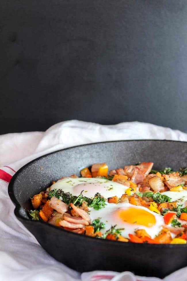 Bacon Kale & Sweet Potato Hash in a cast iron skillet