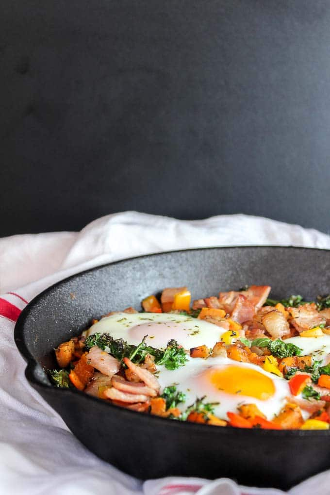 Bacon Kale & Sweet Potato Hash: a sweet and savory one skillet breakfast packed with protein, fiber, and tons of flavor. Low Fodmap & Whole 30 Approved