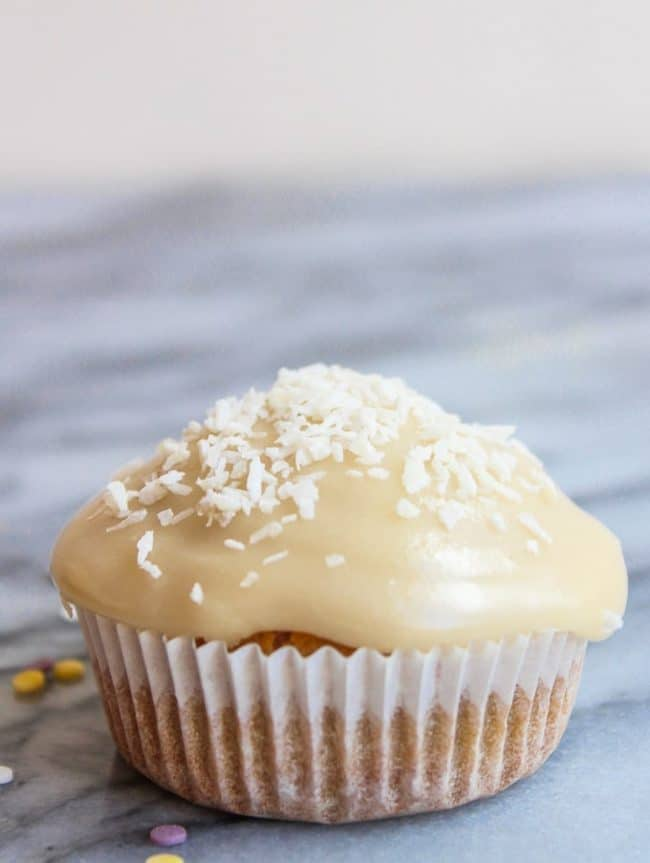 Gluten Free Single Serve Vanilla Cupcake topped with coconut flakes