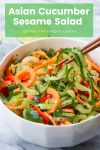 asian cucumber sprializer salad in a bowl with chop sticks and title