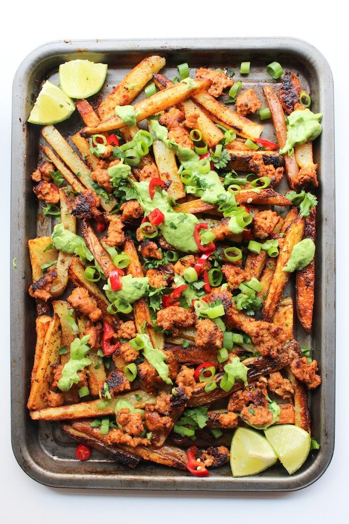 Baked Cajun Fries with Chorizo Sausage & Avocado Crema