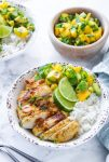 Whole 30 friendly Jerk Chicken in a bowl with rice and mango avocado salsa