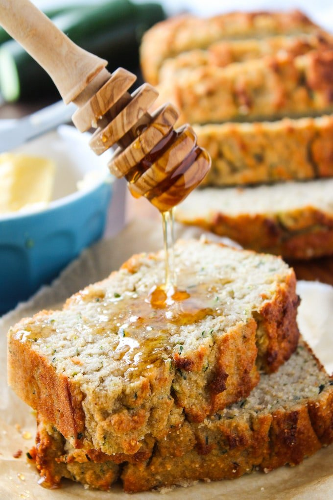 Paleo Zucchini Bread with honey drizzling over the top