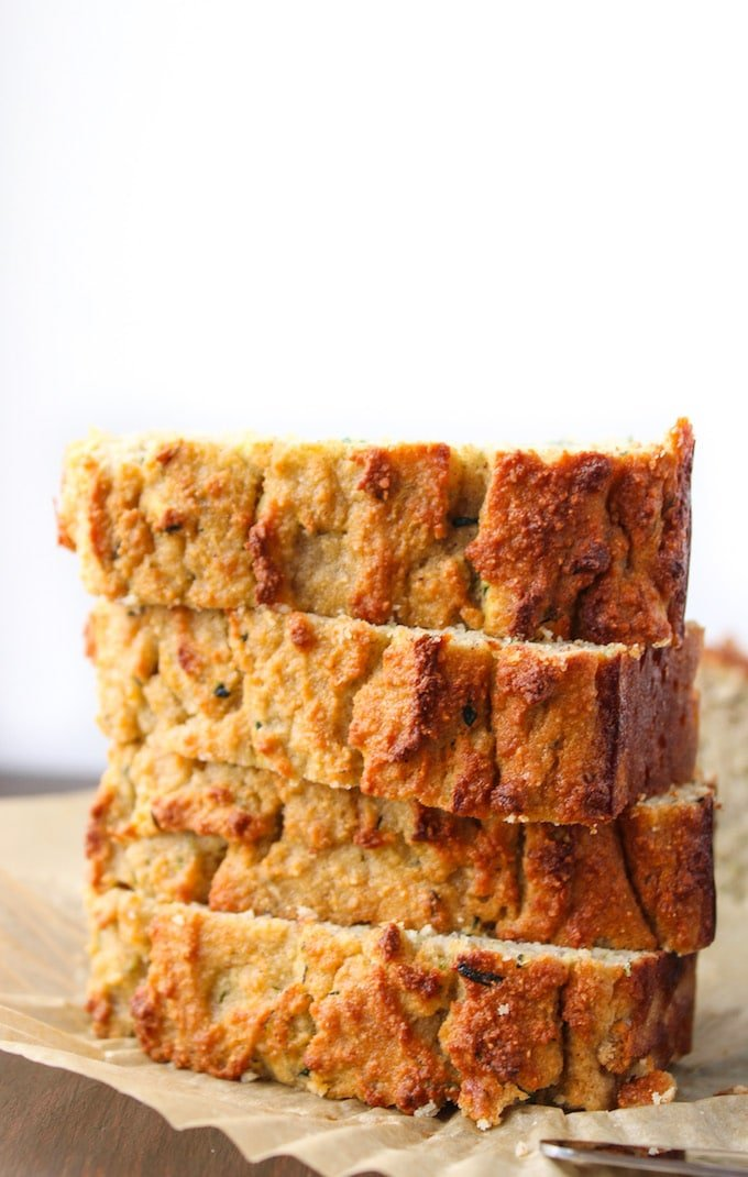 Four Paleo Zucchini Bread slices stacked on top of each other