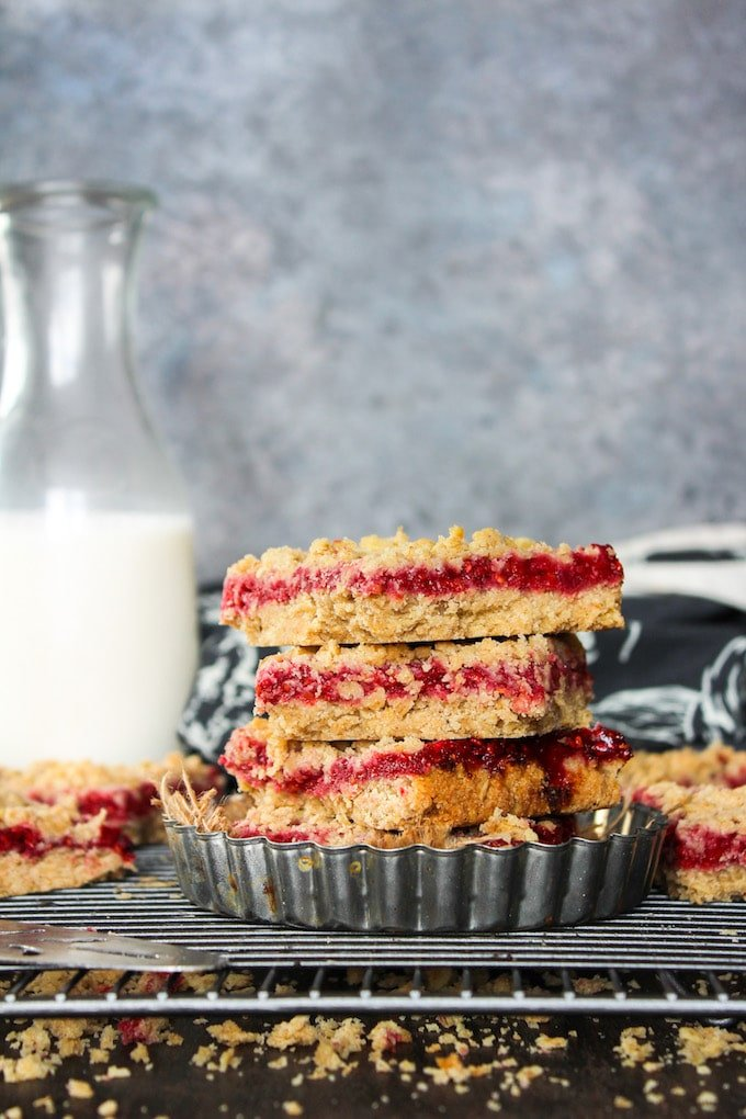 Raspberry Crumble Bars - double the crumble surrounding a sweet and tangy raspberry fruit filling. Gluten free + Low FODMAP + Vegan | www.asaucykitchen.com