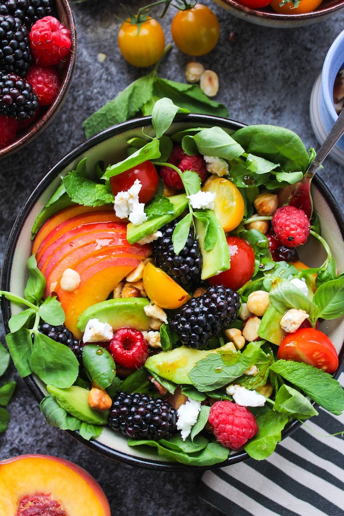 Bright and tangy fruit and nut summer salad with blackberries, raspberries, cherry tomatoes, avocado and toasted hazelnuts - all dressed in a simple balsamic vinaigrette | Paleo, Grain Free, Low Carb