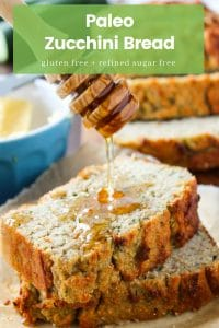 """honey drizzling over the top of two paleo zucchini bread slices with the name and labels written on the top: """"Paleo Zucchini Bread: Gluten Free + Refined Sugar Free"""""""