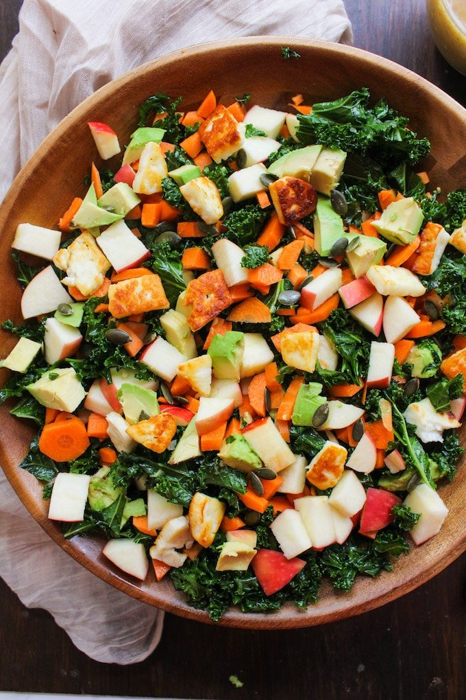 Crunchy Carrot Apple & Massaged Kale Salad topped with halloumi ...