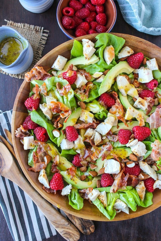Chopped chicken & raspberry salad with sliced avocado, crispy pancetta, and a handful of almonds topped with a creamy maple mustard dressing   paleo + dairy free + low fodmap
