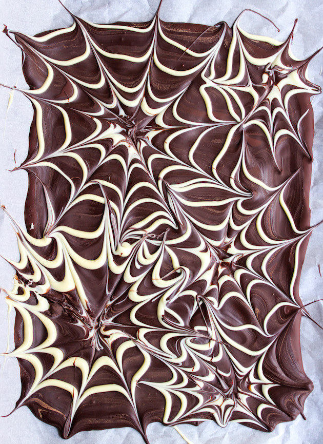 Spider web chocolate bark on a baking sheet