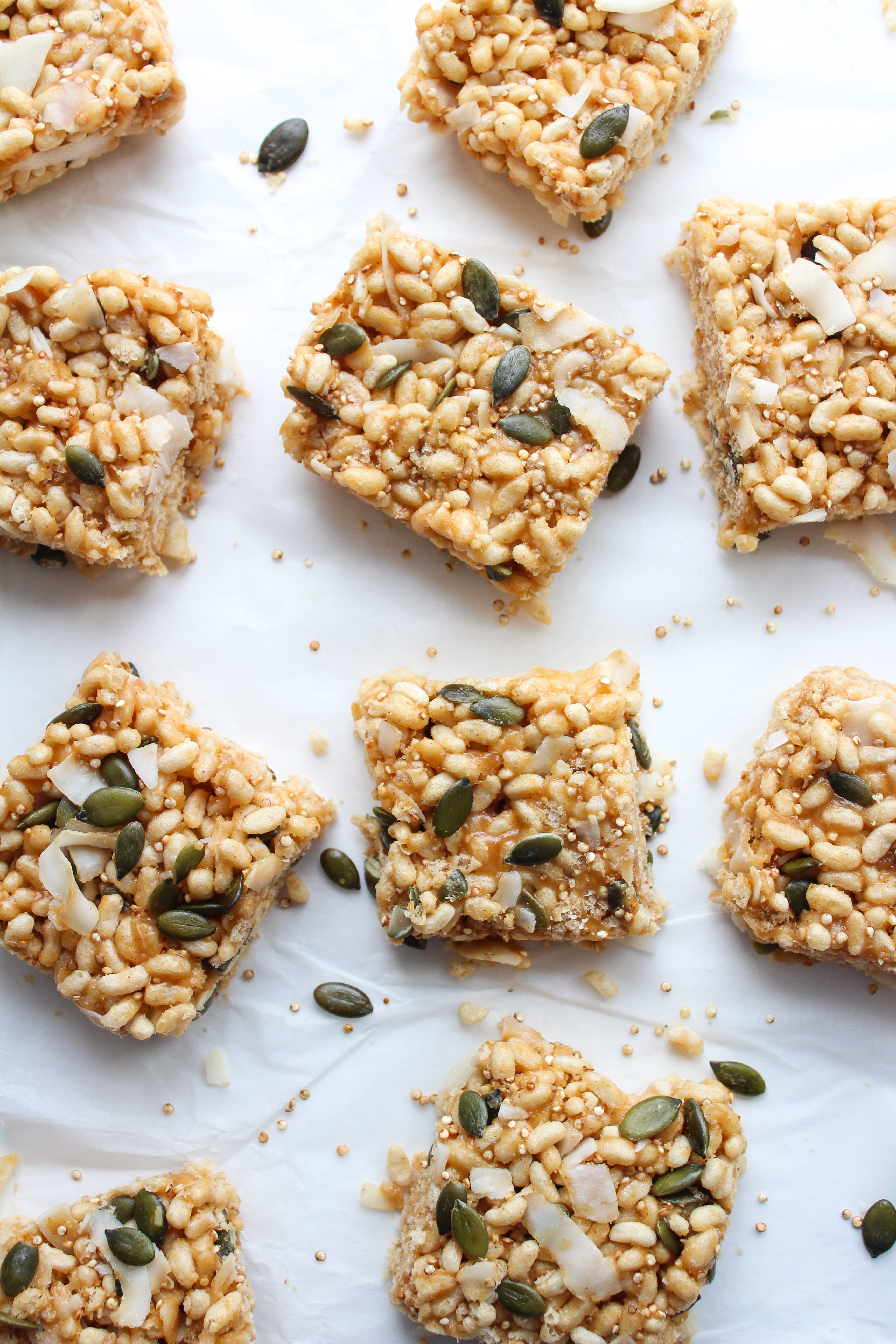 Superfood Vegan Rice Krispie Treats - a childhood favorite reimagined with a few healthier tweaks and additions. Organic puffed brown rice with toasted quinoa, coconut flakes, and pepitas mixed together in a nut butter glue.