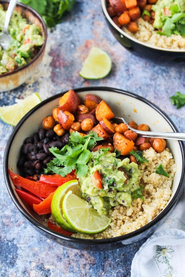 Spicy Chipotle Chickpea Burrito Bowls with roasted sweet potatoes, peppers, black beans and guacamole over a bed of quinoa | vegan + gluten free