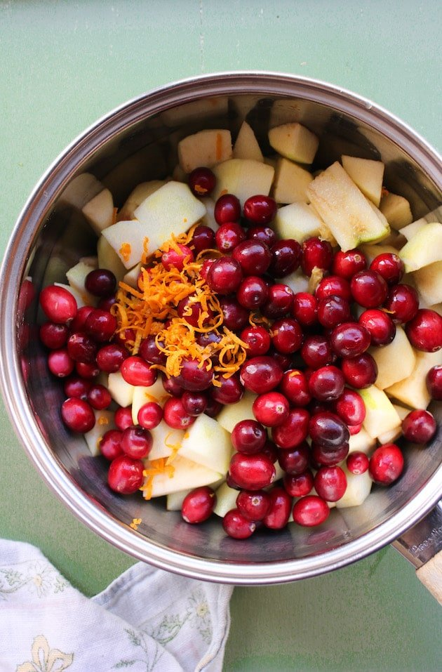 cranberries, apple and orange zest in a sauce pot