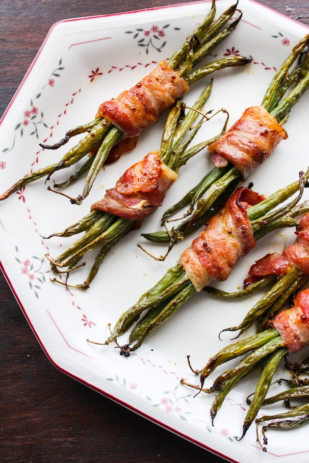 Honey Mustard Bacon Wrapped Green Beans | tender green bean bundles covered in a honey mustard & garlic sauce wrapped in thick slices of salty bacon | paleo + low carb