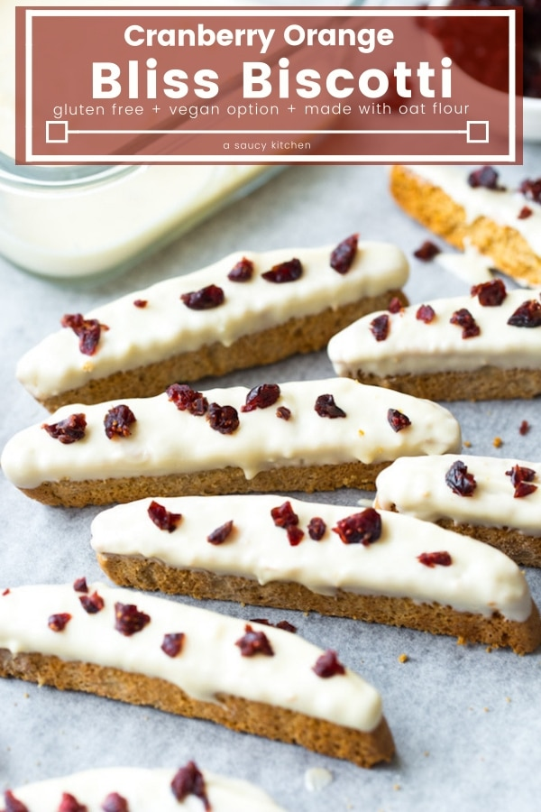 Cranberry Orange Gluten Free Biscotti - gently sweetened and lightly spiced oat flour biscotti dipped in melted white chocolate and topped with chopped cranberries  #glutenfree & #nutfree #cranberry #cranberryorange #biscotti