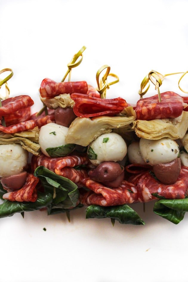 Simple Antipasto Skewers with pepperoni, olives, artichoke, fresh basil & marinated mozzarella balls | An easy yet stylish appetizer | Gluten Free + Low Carb + Grain Free