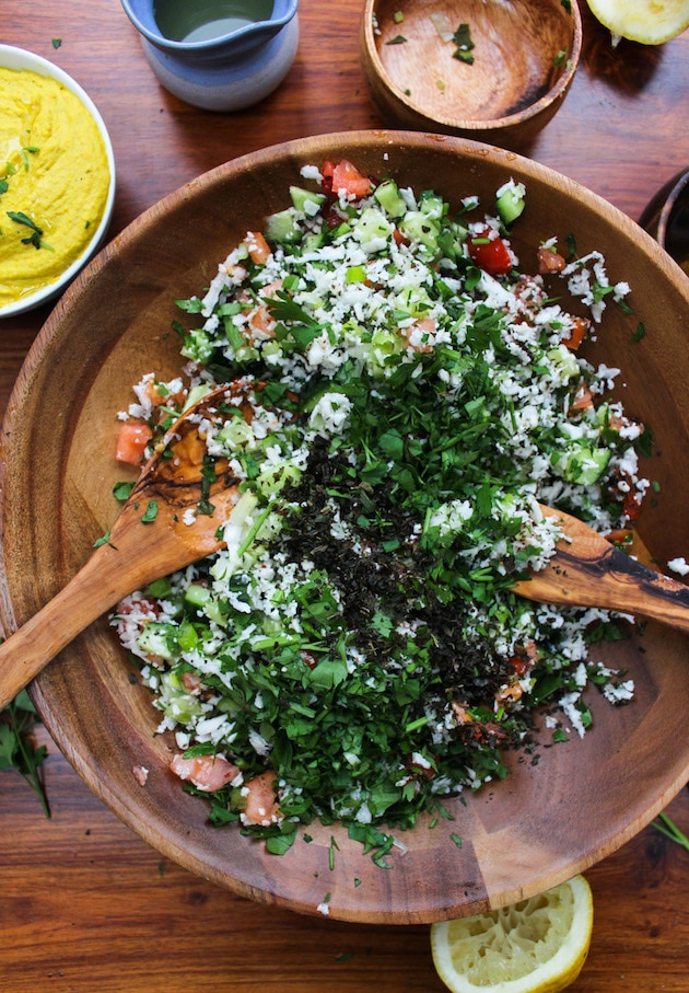 Cauliflower Tabbouleh - a Middle Eastern classic made gluten free | Fresh vegetables & herbs chopped, mixed and dressed in fresh lemon juice | Vegan + Paleo + Whole 30
