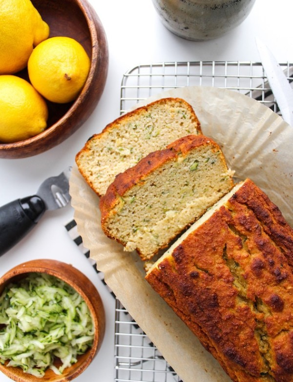 Paleo Lemon and Olive Oil Bread with a couple of slices on a cooling rack