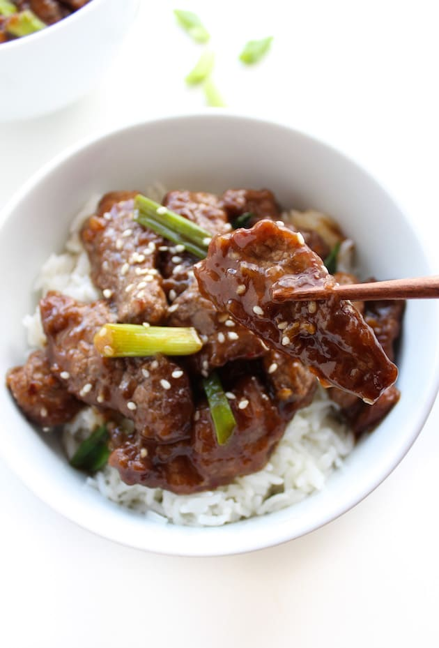 chop sticks holding up Paleo Mongolian Beef
