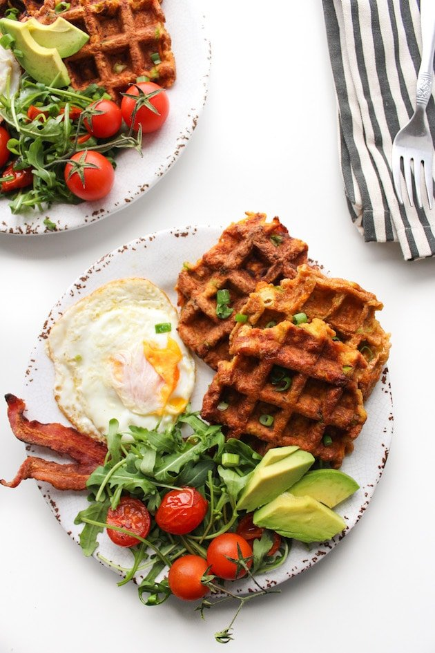 Paleo Sweet Potato Waffles on a plate with eggs and bacon