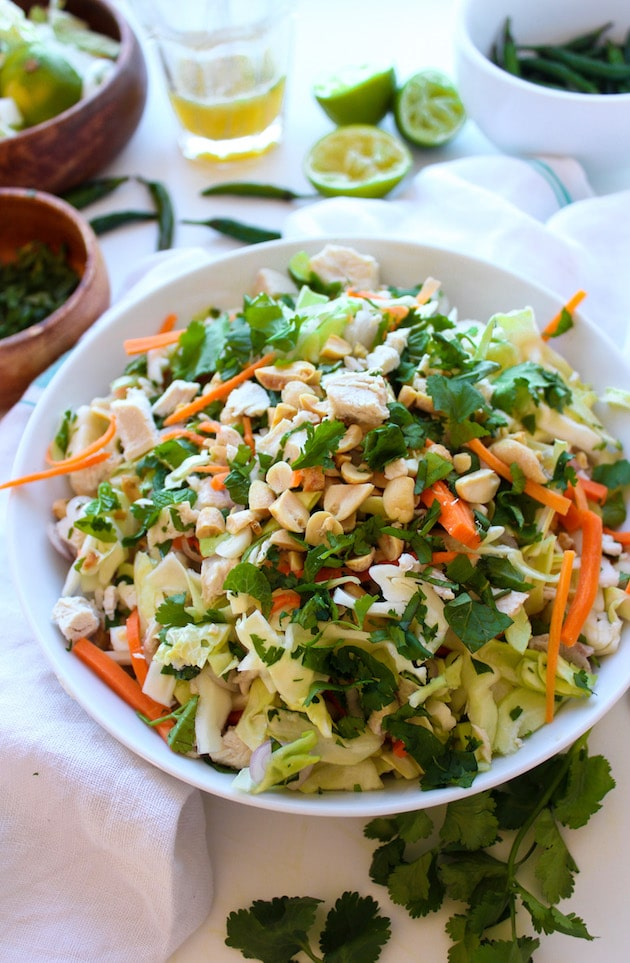 Vietnamese Chicken Salad made with poached or leftover chicken, shredded cabbage, carrots, fresh herbs and a tangy chili lime dressing. Top with peanuts or cashews for a paleo option. | Dairy Free + Gluten Free + Grain Free