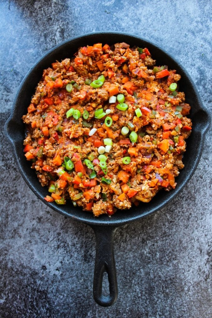 Super simple one pot Taco Skillet packed with veggies, protein, and loads of spice | A perfect, low carb weeknight dinner! Gluten Free + Whole30 & Paleo options – just skip the cheese!