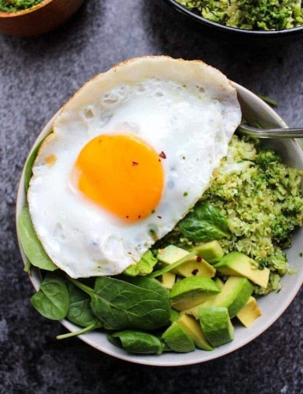 Pesto Cauliflower Rice Bowls topped with an egg and avocado