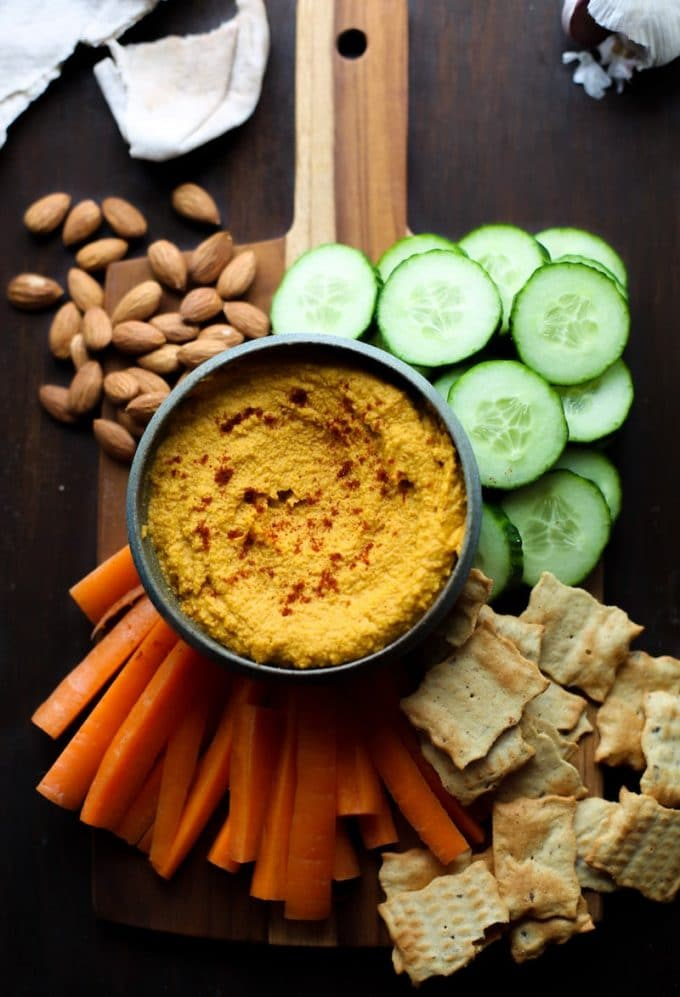 Roasted Carrot Hummus with garlic powder, chilli powder, cinnamon, paprika and sea salt. Warm spicy flavours balanced out with a slightly sweet undertone. Gluten Free + Vegan