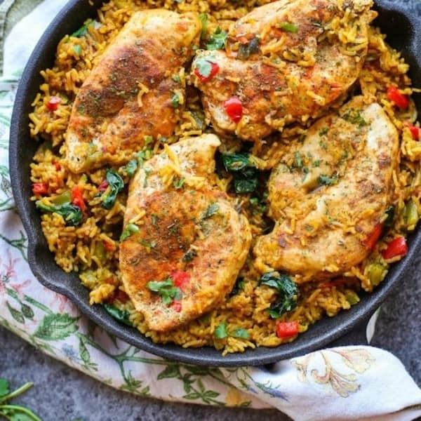 One Pot Low FODMAP Chicken and Rice (Khichdi Inspired) in a cast iron pan