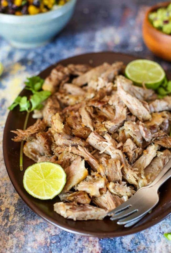 Puerto Rican Instant Pot Pulled Pork with limes and cilantro