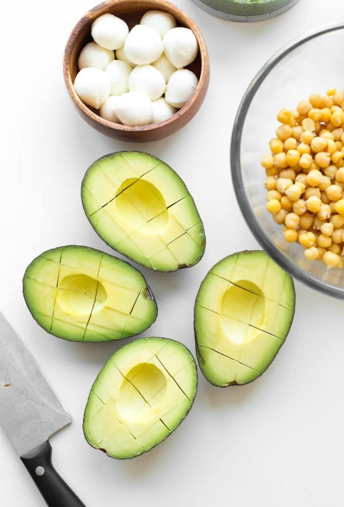 Avocado Chickpea Pesto Salad - sliced avocado in their skins
