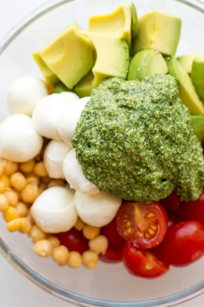 Avocado Chickpea Pesto Salad ingredients in a bowl