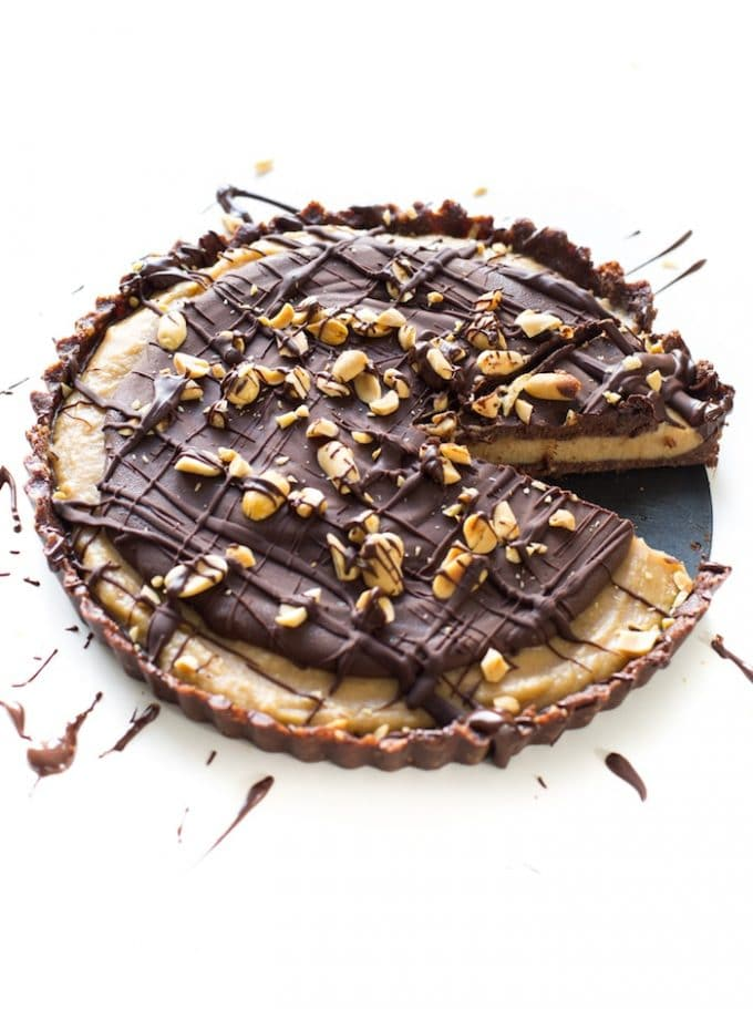 Creamy, dreamy Frozen Vegan Peanut Butter Cup Pie - Made with less than 10 all natural ingredients & easy to make! Grain Free + Vegan + Paleo Option