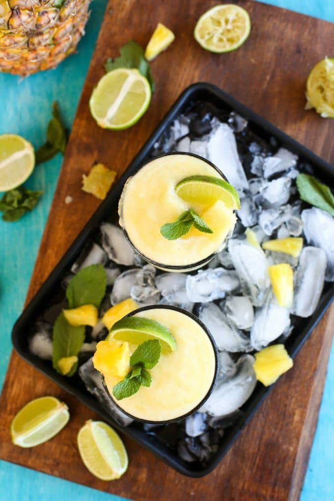 Pineapple, freshly squeezed lime juice, tequila Pineapple, freshly squeezed lime juice, tequila and triple sec are combined in these light, naturally sweetened & refreshing Frozen Pineapple Margaritas! triple sec are combined in these light, naturally sweetened & refreshing Frozen Pineapple Margarita!