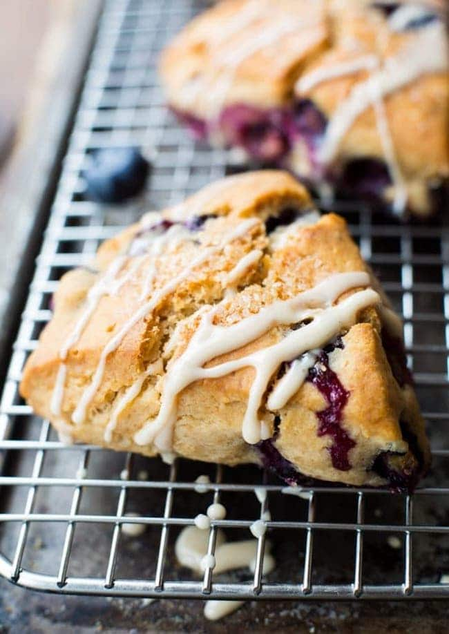 Vegan Gluten Free Blueberry Scones with a simple maple glaze on a cooling rack
