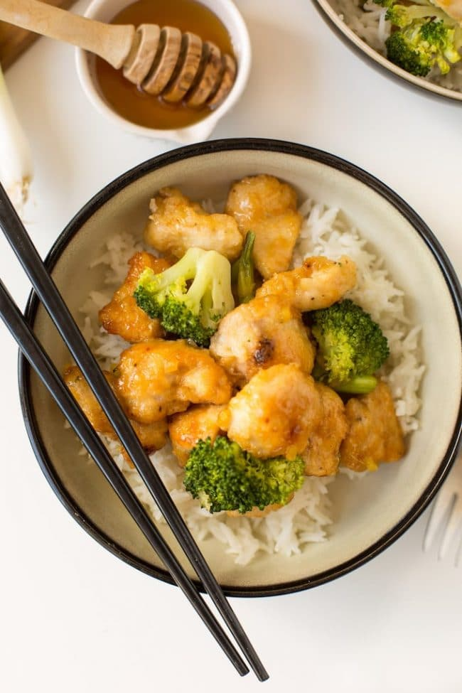 Ginger Honey Chicken in a bowl with broccoli and rice